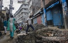 The Hossain Dalan road in Bakshibazar has been dug up to set up sewerage under the street. With no alternative route to avoid the site, people are simply taking the trouble to traverse the muddy path to their destination, risking their personal safety along the way. Photo: Mahmud Zaman Ovi