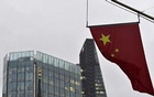 A Chinese national flag flies from the Bank of China in the financial district of the City of London, Britain January 7, 2016. REUTERS
