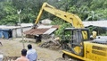 Chattogram Development Authority bulldozed illegal structures along Bayezid-Faujdarhat Link Road on Monday, Jun 14, 2021 over fears of landslide. Photo: Suman Babu