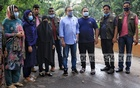 Businessman and Dhaka Boat Club member Nasir U Mahmood (jeans pants and sky blue shirt) at the police's Detective Branch office in Dhaka after his arrest along with four others at Uttara on Monday, Jun 14, 2021 in a case filed by film actress Pori Moni on charges of attempted rape and murder.