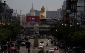 The giant Buddha statue of Wat Paknam Phasi Charoen temple is seen at the end of an avenue amid the coronavirus disease (COVID-19) outbreak in Bangkok, Thailand, Jun 9, 2021. REUTERS