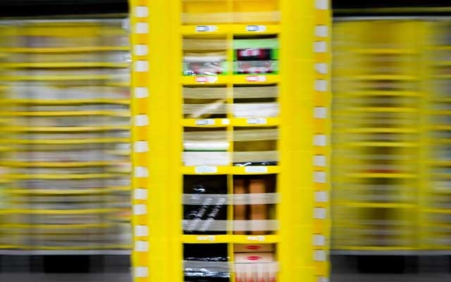A robot carries items to be packed into boxes at Amazon's warehouse on Staten Island, called JFK8, on March 2, 2021. The New York Times