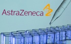 Test tubes are seen in front of a displayed AstraZeneca logo in this illustration taken, May 21, 2021. REUTERS