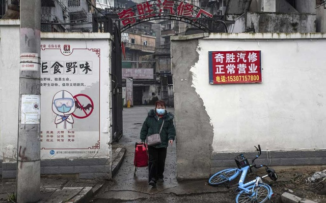 A propaganda poster advising against the consumption of wild animals in Wuhan, China, on Jan 22, 2021. Those in favour of the coronavirus natural origins hypothesis have pointed to a recent study that showed that just before the pandemic hit, the city's markets were selling many animal species capable of harboring dangerous pathogens that could jump to humans. The New York Times