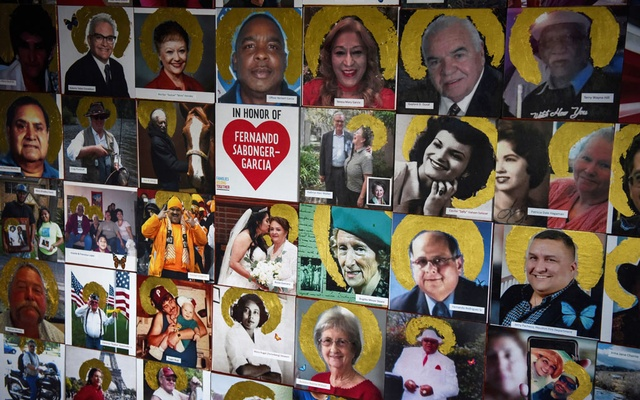 A portion of a mural, which displays images of people who have died of coronavirus disease (COVID-19), is seen in Joni Zavitsanos' art studio as the country reaches 600,000 deaths in Houston, Texas, US, June 10, 2021. Reuters
