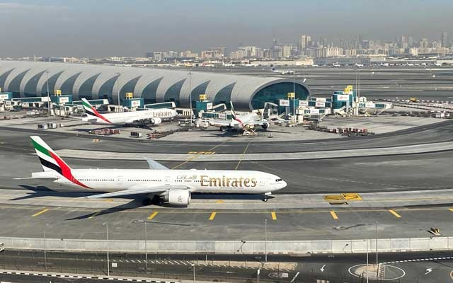 Emirates airliners are seen on the tarmac in a general view of Dubai International Airport in Dubai, United Arab Emirates January 13, 2021