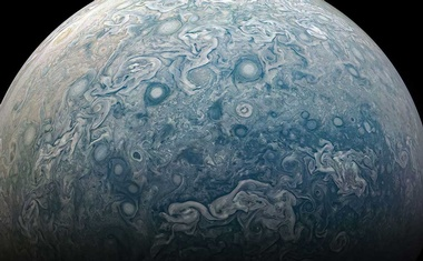 Storms on Jupiter's northern hemisphere, captured by Juno's 24th flyby of the planet in December 2019. Juno is now finishing its primary mission, but NASA has granted it a four-year extension and 42 more orbits. (NASA via The New York Times)