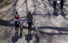 People walk their dogs through Central Park on spring equinox, in the Manhattan borough of New York City, New York, US, March 20, 2021. REUTERS/Caitlin Ochs