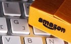 FILE PHOTO: A 3D printed Amazon postal package is placed on a keyboard in this illustration taken March 25, 2020. REUTERS/Dado Ruvic/Illustration/File Photo