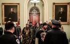 United States Capitol Police confront rioters who breached the Capitol in Washington on Jan 6, 2021. The New York Times