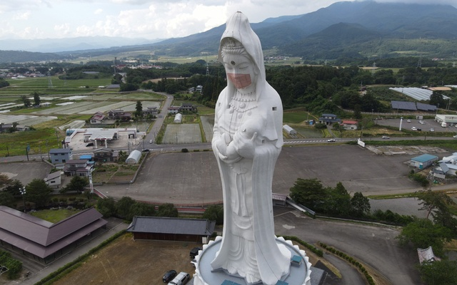 A drone picture shows a mask placed on a 57-metre-high statue of Buddhist goddess Kannon, to pray for the end of the coronavirus disease (COVID-19) pandemic at Houkokuji Aizu Betsuin temple in Aizuwakamatsu, Fukushima Prefecture, Japan in this handout photo taken on June 15 2021. REUTERS