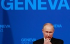 Russia's President Vladimir Putin holds a news conference after the summit. REUTERS/Denis Balibouse/Pool