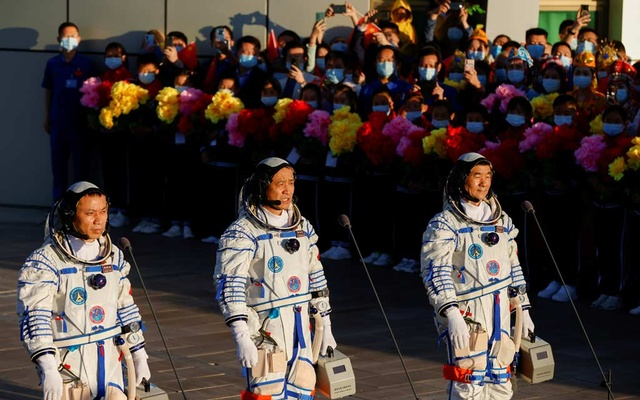 Chinese astronauts Tang Hongbo, Nie Haisheng and Liu Boming speak before the launch of the Long March-2F Y12 rocket, carrying the Shenzhou-12 spacecraft and the three astronauts, from Jiuquan Satellite Launch Centre for China's first manned mission to build its space station, near Jiuquan, Gansu province, China June 17, 2021. REUTERS/Carlos Garcia Rawlins