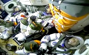 Chinese astronauts Nie Haisheng, Liu Boming, and Tang Hongbo are seen inside the Shenzhou-12 spacecraft as China launches the spacecraft via the Long March-2F Y12 carrier rocket on its first manned mission to build the country's space station from Jiuquan Satellite Launch Center near Jiuquan, Gansu province, China, in this still image taken from a video June 17, 2021. CCTV via Reuters