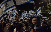 Supporters of the Likud Party and Prime Minister Benjamin Netanyahu rally outside the prime minister's residence on Balfour Street in Jerusalem after Parliament's vote on Sunday night, June 13, 2021. Unlike in Washington, there is no set time by which an outgoing Israeli premier must move out and hand the house over to the victor and it can often take weeks. (Amit Elkayam/The New York Times)
