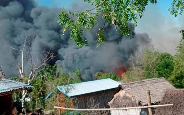 A view shows smoke from the fire in Kin Ma Village, Pauk Township, Magway Region, Myanmar Jun 16, 2021. Reuters
