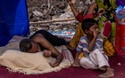 A Rohingya refugee family rests in a temporary shelter after a fire destroyed a Rohingya refugee camp on Saturday night, in New Delhi, India, June 14, 2021. REUTERS/Danish Siddiqui