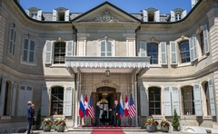 From left, President Vladimir Putin of Russia and President Joe Biden greet each other as they arrive for their meeting at Villa La Grange in Geneva on Wednesday, June 16, 2021. The New York Times