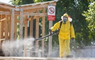 A specialist wearing personal protective equipment (PPE) sprays disinfectant while sanitising the Rizhsky Railway Station, one of the measures to curb the spread of the coronavirus disease (COVID-19), in Moscow, Russia June 17, 2021. Moscow Division of Russian Emergencies Ministry/Handout via REUTERS