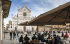 Outdoor seating for a café at Piazza Santa Croce in Florence, Italy, May 15, 2021. The European Union is recommending that its 27 member nations lift a ban on nonessential travel from the United States, but each country will decide for itself. Susan Wright/The New York Times