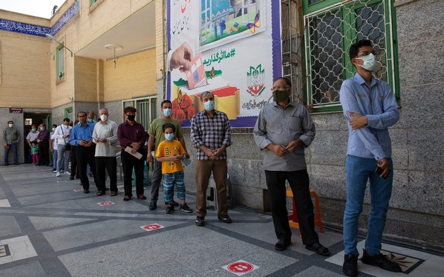 People line up to vote in Tehran, Iran, on Friday, June 18, 2021, during the presidential election. Many moderate-leaning Iranians appear to be planning to sit the election out, according to polls, commentary and interviews. (Arash Khamooshi/The New York Times)
