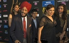 Former Indian track and field athlete Milkha Singh (2nd L) walks the green carpet with his family as they arrive for the 15th annual International Indian Film Awards in Tampa, Florida, April 26, 2014. REUTERS/