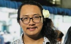 Myanmar rights activist Thet Swe Win wears a flower in his hair in this handout picture on the birthday of detained leader Aung San Suu Kyi at an undisclosed location in Myanmar, Jun 19, 2021. REUTERS