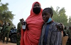 A woman looks on as he receives her son, who had been rescued by the Nigerian security forces in Katsina, Nigeria, December 18, 2020. REUTERS/Afolabi Sotunde