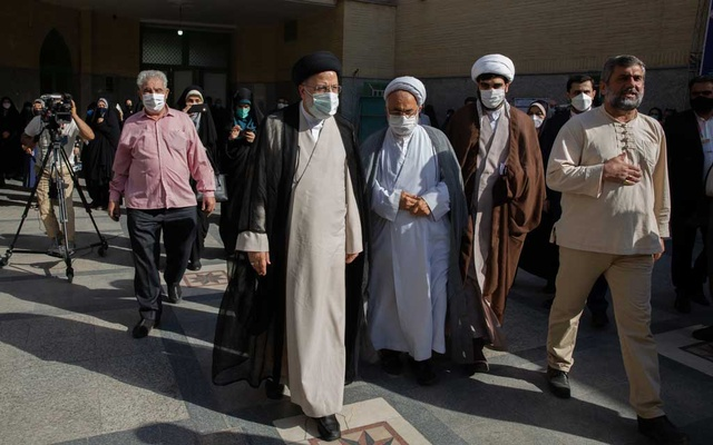 Ebrahim Raisi, an Iranian presidential candidate, arrives at a polling station in Tehran, Iran, June 18, 2021. Raisi, who is accused of grave human rights violations, has also been penalized by the European Union. The New York Times