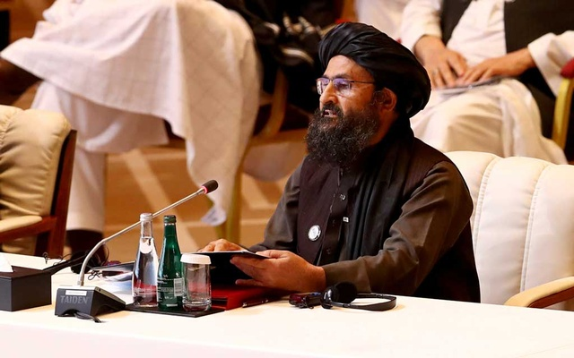 Mullah Abdul Ghani Baradar, the leader of the Taliban delegation, speaks during talks between the Afghan government and Taliban insurgents in Doha, Qatar September 12, 2020. REUTERS