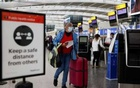 A passenger walks with her luggage at the Terminal 5 departures area at Heathrow Airport in London, Britain, May 17, 2021. REUTERS