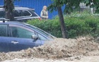 A car is parked in a flooded street following heavy rainfall in Yalta, Crimea June 18, 2021. REUTERS/Alexey Pavlishak