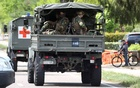 Belgian army ambulance and soldiers arrive at National Park Hoge Kempen while scouring to capture Belgian Jurgen Conings, a soldier who disappeared after threatening a virologist supportive of coronavirus disease (COVID-19) vaccines and coronavirus restrictions, in Maasmechelen, Belgium May 21, 2021. REUTERS