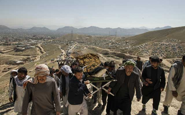 People perform a funeral ceremony on May 9, 2021, for a girl killed in powerful explosions outside a high school in a predominantly Hazara neighborhood in Kabul, Afghanistan. The New York Times