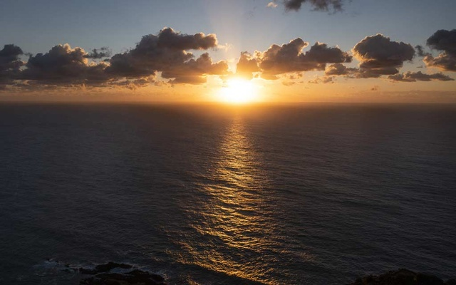 FILE -- An aerial view of Byron Bay, Australia, April 27, 2021. Going to bed early and waking up early may help to provide some protection against depression, a new study suggests. (Matthew Abbott/The New York Times)