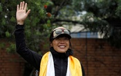 Hong Kong's Tsang Yin-Hung, 45, who scaled Mount Everest in less than 26 hours, the shortest time taken by any woman after starting from the base camp, waves for a picture upon her arrival after climbing Everest, in Kathmandu, Nepal May 30, 2021. REUTERS