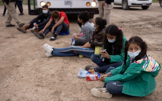 Chanel, 7, and her sister Adriana, 10, both unaccompanied minors traveling alone from Honduras, sits among other asylum-seeking children as they await to be transported to a US border patrol processing facility after crossing the Rio Grande river into the United States from Mexico in La Joya, Texas, US, May 6, 2021. REUTERS