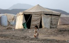 A girl walks past a tent at a camp for internally displaced people (IDPs) in Marib, Yemen April 5, 2021. REUTERS