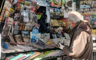 A man wears a protective face mask and gloves at the newsstand as the Italian government allows the reopening of some shops while a nationwide lockdown continues following the outbreak of the coronavirus disease (COVID-19), in Venice, Italy, April 14, 2020