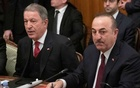 Turkish Foreign Minister Mevlut Cavusoglu (R) and Defence Minister Hulusi Akar (L) attend a meeting with Russian Foreign Minister Sergei Lavrov and Defence Minister Sergei Shoigu in Moscow, Russia January 13, 2020. Pavel Golovkin/Pool via REUTERS