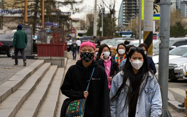 Pedestrians wear face masks in Ulaanbaatar, Mongolia, on May 12, 2021. The New York Times