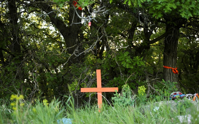 Shoes, stuffed animals, dream catchers and other offerings are seen at the site of the former Brandon Indian Residential School where researchers, partnered with the Sioux Valley Dakota Nation, located 104 potential graves in Brandon, Manitoba, Canada, June 12, 2021. Reuters