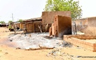 A view shows damaged buildings and huts at the site of an attack in the village of Solhan, in Yagha province bordering Niger, Burkina Faso June 7, 2021. Burkina Faso Prime Minister's Press Service/Handout via REUTERS