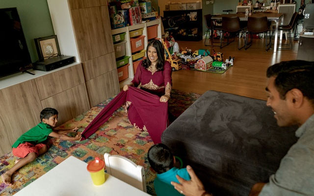 Sushma Dwivedi at home with her husband, Vivek Jindal, and their sons, Ashwin and Nayan, in Harlem, June 18, 2021. As a Hindu pundit, or priest, who focuses on the LGBTQ population, Dwivedi is a rarity in the wedding industry. (Amr Alfiky/The New York Times)
