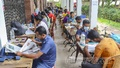 Students chasing jobs are studying for recruitment tests on the veranda of the library at Dhaka University's Faculty of Science. Photo: Asif Mahmud Ove