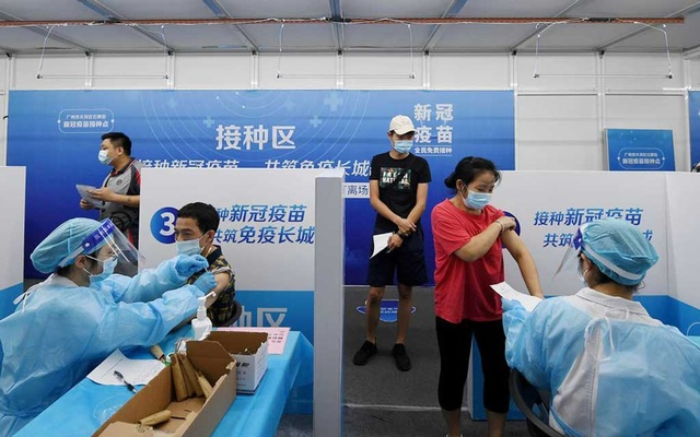 Residents receive vaccines against the coronavirus disease (COVID-19) at a makeshift vaccination site in Guangzhou, Guangdong province, China June 21, 2021. cnsphoto via REUTERS