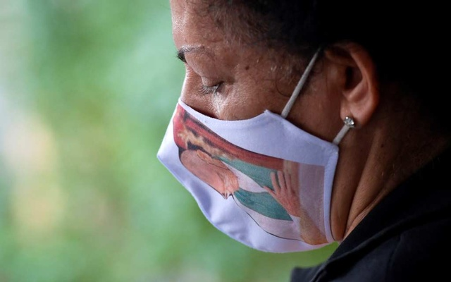 A member of the Cunha family, Ivanilda Cunha, who lost family members during the coronavirus disease (COVID-19) pandemic, poses for a picture in Belo Horizonte, Brazil, May 16, 2021. REUTERS