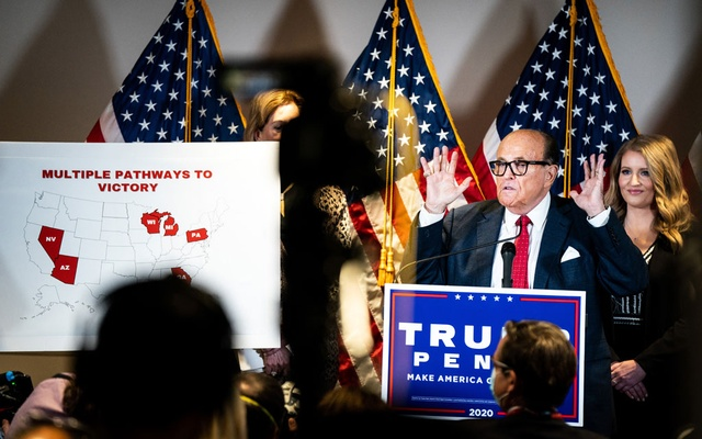 """Rudy Giuliani, then-President Donald Trump's attorney, speaks to reporters at the offices of the Republican National Committee in Washington on Nov. 19, 2020. A New York appellate court suspended Giuliani's law license on Thursday, June 24, 2021, after a disciplinary panel found that he made """"demonstrably false and misleading"""" statements about the 2020 election as Trump's personal lawyer. (Erin Schaff/The New York Times)"""