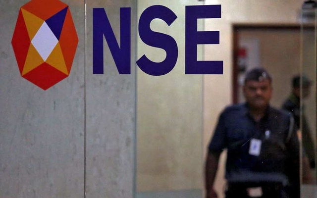 A security guard walks past the logo of the National Stock Exchange (NSE) inside its building in Mumbai, India, May 28, 2019. REUTERS