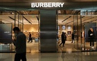 A man walks past a store of luxury brand Burberry at a shopping mall in Beijing, China Mar 26, 2021. REUTERS